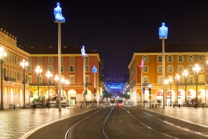 Place Masséna showing art installation of giant glowing buddhas on plinths by Jaume Plensa
