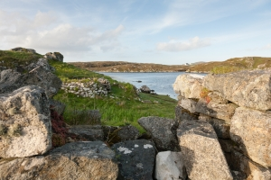 View from a ruined Blackhouse in the island of Barra. Visible is the remains of the window and the foreshore of the beach.