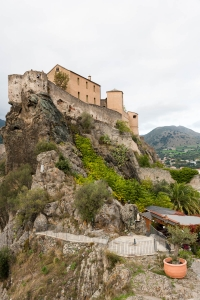 Close up shot showing the castle of Corte perched on a rocky cliff.