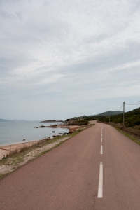Evening setting while looking down the road beside the bay near Lieu dit Santa Manza.